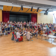 Twice annually the great choir and orchestra of the Circle of Friends come together to make CD recordings of self-composed pieces at which many young people also collaborate.
